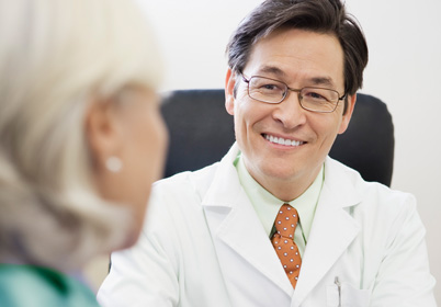 doctor sitting and smiling with patient